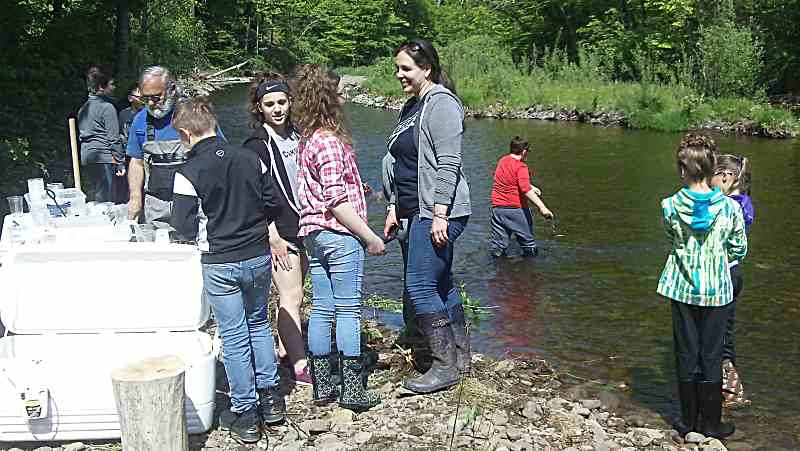 students stocking fish